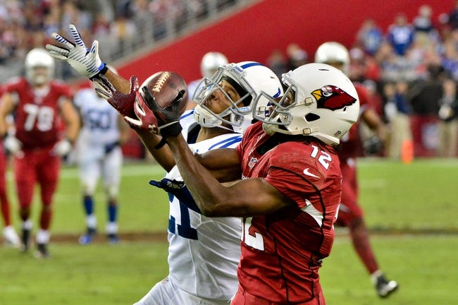 Nov 24, 2013; Phoenix, AZ, USA; Arizona Cardinals wide receiver Andre Roberts (12) makes a catch as Indianapolis Colts defensive back Jalil Brown (21) defends during the second half at University of Phoenix Stadium. Mandatory Credit: Matt Kartozian-USA TODAY Sports