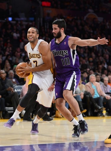 Nov 24, 2013; Los Angeles, CA, USA;   Los Angeles Lakers small forward Xavier Henry (7) is guarded by Sacramento Kings point guard Greivis Vasquez (10) in the first half of the game at Staples Center. Mandatory Credit: Jayne Kamin-Oncea-USA TODAY Sports