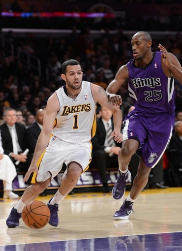 Nov 24, 2013; Los Angeles, CA, USA;   Sacramento Kings small forward Travis Outlaw (25) guards Los Angeles Lakers point guard Jordan Farmar (1) in the first half of the game at Staples Center. Mandatory Credit: Jayne Kamin-Oncea-USA TODAY Sports