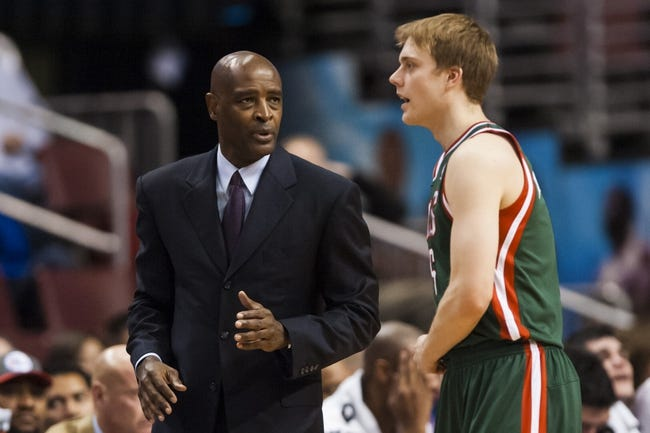 Nov 22, 2013; Philadelphia, PA, USA; Milwaukee Bucks head coach Larry Drew talks with guard Nate Wolters (6) during the third quarter against the Philadelphia 76ers at Wells Fargo Center. The Sixers defeated the Bucks 115-107 in overtime. Mandatory Credit: Howard Smith-USA TODAY Sports