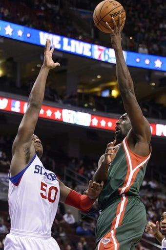 Nov 22, 2013; Philadelphia, PA, USA; Milwaukee Bucks center Ekpe Udoh (5) shoots over the defense of Philadelphia 76ers center Lavoy Allen (50) during the third quarter at Wells Fargo Center. The Sixers defeated the Bucks 115-107 in overtime. Mandatory Credit: Howard Smith-USA TODAY Sports