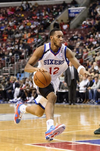 Nov 22, 2013; Philadelphia, PA, USA; Philadelphia 76ers guard Evan Turner (12) during the fourth quarter against the Milwaukee Bucks at Wells Fargo Center. The Sixers defeated the Bucks 115-107 in overtime. Mandatory Credit: Howard Smith-USA TODAY Sports