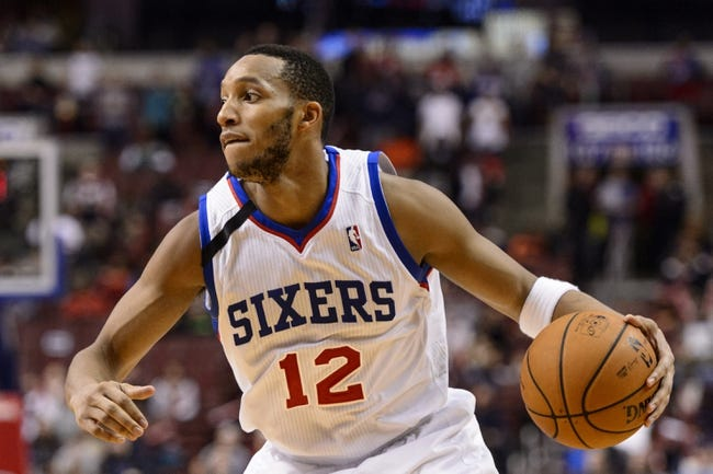 Nov 22, 2013; Philadelphia, PA, USA; Philadelphia 76ers guard Evan Turner (12) during overtime against the Milwaukee Bucks at Wells Fargo Center. The Sixers defeated the Bucks 115-107 in overtime. Mandatory Credit: Howard Smith-USA TODAY Sports