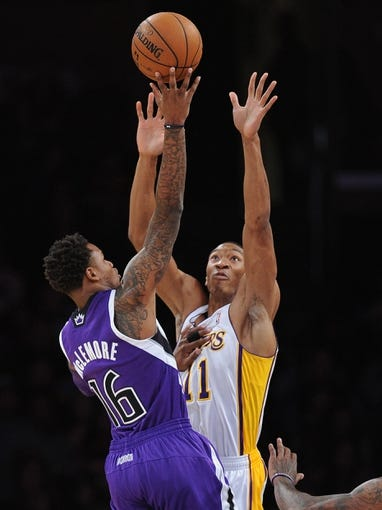 Nov 24, 2013; Los Angeles, CA, USA;  Sacramento Kings shooting guard Ben McLemore (16) shoots over Los Angeles Lakers shooting guard Wesley Johnson (11) during the game at Staples Center. Lakers won 100-86. Mandatory Credit: Jayne Kamin-Oncea-USA TODAY Sports
