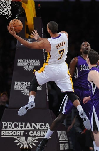 Nov 24, 2013; Los Angeles, CA, USA;  Los Angeles Lakers small forward Xavier Henry (7) during the game against the Sacramento Kings at Staples Center. Lakers won 100-86. Mandatory Credit: Jayne Kamin-Oncea-USA TODAY Sports