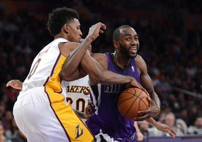 Nov 24, 2013; Los Angeles, CA, USA;  Los Angeles Lakers small forward Nick Young (0) knocks the ball from the hand of Sacramento Kings power forward Luc Richard Mbah a Moute (33) during the second half of the game at Staples Center. Lakers won 100-86. Mandatory Credit: Jayne Kamin-Oncea-USA TODAY Sports