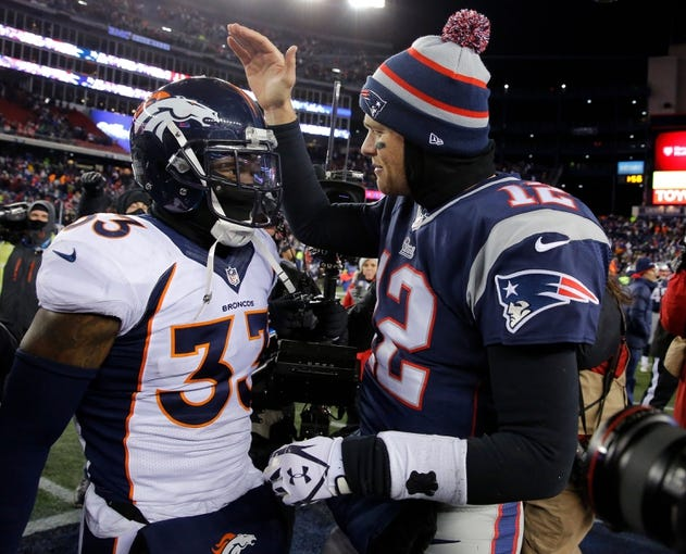 Nov 24, 2013; Foxborough, MA, USA; New England Patriots quarterback Tom Brady (12) greets Denver Broncos strong safety Duke Ihenacho (33) on the field after the game at Gillette Stadium. The New England Patriots defeated the Denver Broncos 34-31. Mandatory Credit: David Butler II-USA TODAY Sports