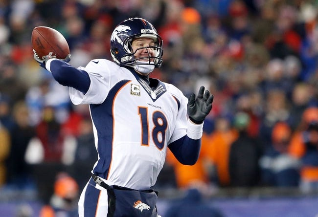 Nov 24, 2013; Foxborough, MA, USA; Denver Broncos quarterback Peyton Manning (18) throws a pass against the New England Patriots in the fourth quarter at Gillette Stadium. The New England Patriots defeated the Denver Broncos 34-31. Mandatory Credit: David Butler II-USA TODAY Sports