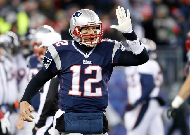 Nov 24, 2013; Foxborough, MA, USA; New England Patriots quarterback Tom Brady (12) reacts after a touchdown against the Denver Broncos in the third quarter at Gillette Stadium. The New England Patriots defeated the Denver Broncos 34-31. Mandatory Credit: David Butler II-USA TODAY Sports