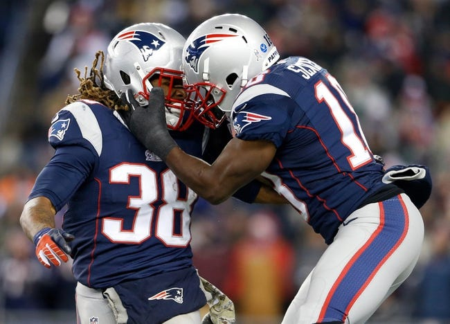 Nov 24, 2013; Foxborough, MA, USA; New England Patriots running back Brandon Bolden (38) and wide receiver Matthew Slater (18) react after a play in the third quarter at Gillette Stadium. The New England Patriots defeated the Denver Broncos 34-31. Mandatory Credit: David Butler II-USA TODAY Sports
