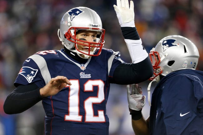 Nov 24, 2013; Foxborough, MA, USA;  New England Patriots quarterback Tom Brady (12) reacts after a touchdown against the Denver Broncos in the fourth quarter at Gillette Stadium. Mandatory Credit: David Butler II-USA TODAY Sports