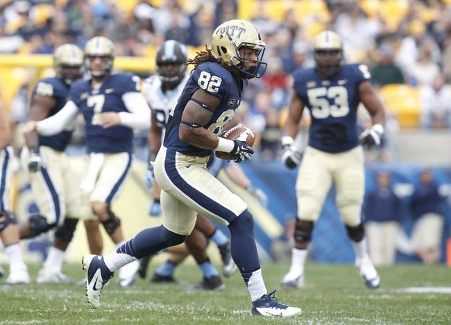 Nov 16, 2013; Pittsburgh, PA, USA; Pittsburgh Panthers tight end Manasseh Garner (82) runs after a pass reception against the North Carolina Tar Heels during the first quarter at Heinz Field. North Carolina won 34-27. Mandatory Credit: Charles LeClaire-USA TODAY Sports