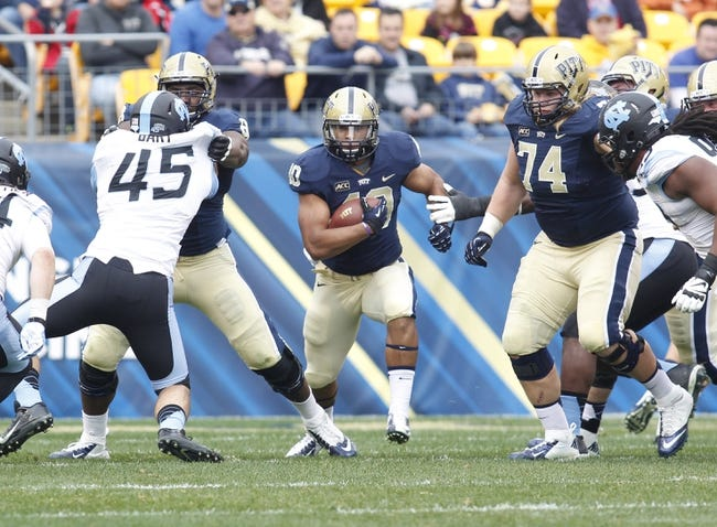 Nov 16, 2013; Pittsburgh, PA, USA; Pittsburgh Panthers running back James Conner (40) breaks through the line of scrimmage against the North Carolina Tar Heels during the first quarter at Heinz Field. North Carolina won 34-27. Mandatory Credit: Charles LeClaire-USA TODAY Sports