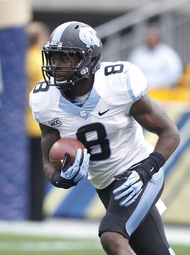 Nov 16, 2013; Pittsburgh, PA, USA; North Carolina Tar Heels running back T.J. Logan (8) returns a kick-off against the Pittsburgh Panthers during the first quarter at Heinz Field. North Carolina won 34-27. Mandatory Credit: Charles LeClaire-USA TODAY Sports