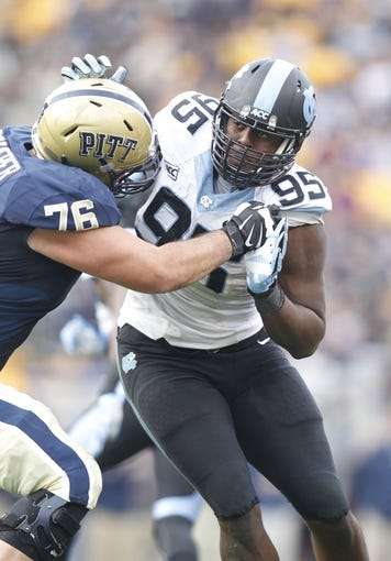 Nov 16, 2013; Pittsburgh, PA, USA; North Carolina Tar Heels defensive end Kareem Martin (95) rushes at the line of scrimmage against Pittsburgh Panthers offensive linesman Ryan Schlieper (76) during the second quarter at Heinz Field. North Carolina won 34-27. Mandatory Credit: Charles LeClaire-USA TODAY Sports