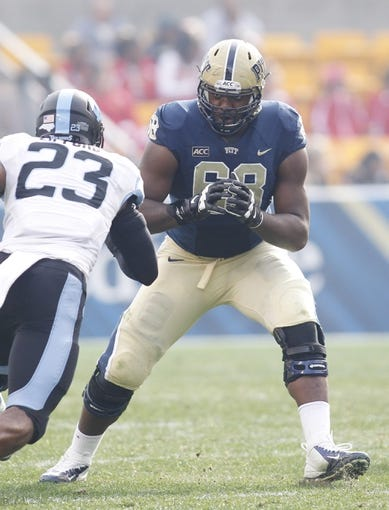 Nov 16, 2013; Pittsburgh, PA, USA; Pittsburgh Panthers offensive linesman T.J. Clemmings (68) prepares to block at the line of scrimmage against North Carolina Tar Heels linebacker Darius Lipford (23) during the second quarter at Heinz Field. North Carolina won 34-27. Mandatory Credit: Charles LeClaire-USA TODAY Sports