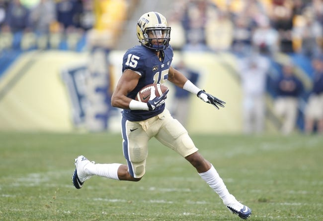 Nov 16, 2013; Pittsburgh, PA, USA; Pittsburgh Panthers wide receiver Devin Street (15) runs after a pass reception against the  North Carolina Tar Heels during the fourth quarter at Heinz Field. The Tar Heels won 34-27. Mandatory Credit: Charles LeClaire-USA TODAY Sports