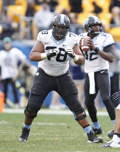Nov 16, 2013; Pittsburgh, PA, USA; North Carolina Tar Heels guard Landon Turner (78) blocks at the line of scrimmage against the Pittsburgh Panthers during the fourth quarter at Heinz Field. North Carolina won 34-27. Mandatory Credit: Charles LeClaire-USA TODAY Sports