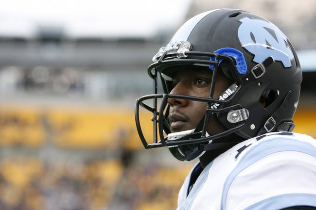 Nov 16, 2013; Pittsburgh, PA, USA; North Carolina Tar Heels quarterback Marquise Williams (12) looks on from the sidelines against the Pittsburgh Panthers during the third quarter at Heinz Field. North Carolina won 34-27. Mandatory Credit: Charles LeClaire-USA TODAY Sports
