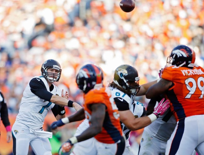Oct 13, 2013; Denver, CO, USA; Jacksonville Jaguars quarterback Chad Henne (7) throws the ball during the game against the Denver Broncos at Sports Authority Field at Mile High. Mandatory Credit: Chris Humphreys-USA TODAY Sports