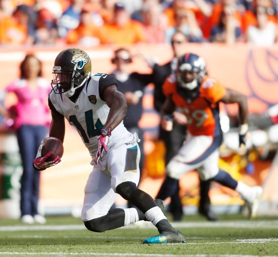 Oct 13, 2013; Denver, CO, USA; Jacksonville Jaguars wide receiver Justin Blackmon (14) during the game against the Denver Broncos at Sports Authority Field at Mile High. Mandatory Credit: Chris Humphreys-USA TODAY Sports