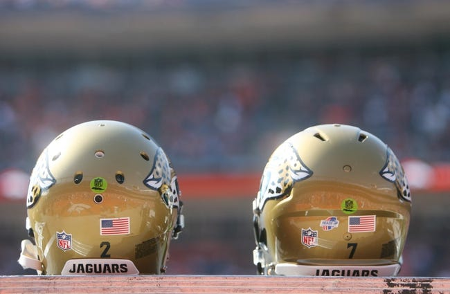 Oct 13, 2013; Denver, CO, USA; The helmets of Jacksonville Jaguars quarterbacks Chad Henne (7) and Ricky Stanzi (2) before the game against the Denver Broncos at Sports Authority Field at Mile High. Mandatory Credit: Chris Humphreys-USA TODAY Sports