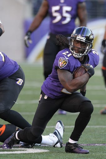 Nov 10, 2013; Baltimore, MD, USA; Baltimore Ravens cornerback Lardarius Webb (21) in action against the Cincinnati Bengals at M&T Bank Stadium. Mandatory Credit: Mitch Stringer-USA TODAY Sports