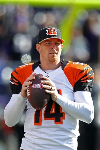 Nov 10, 2013; Baltimore, MD, USA;  Cincinnati Bengals quarterback Andy Dalton (14) warms up prior to the game against the Baltimore Ravens at M&T Bank Stadium. Mandatory Credit: Mitch Stringer-USA TODAY Sports