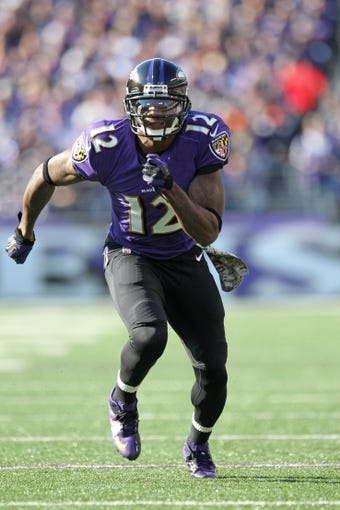 Nov 10, 2013; Baltimore, MD, USA; Baltimore Ravens wide receiver Jacoby Jones (12) runs out for a pass against the Cincinnati Bengals at M&T Bank Stadium. Mandatory Credit: Mitch Stringer-USA TODAY Sports