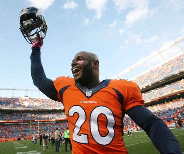 Oct 13, 2013; Denver, CO, USA; Denver Broncos safety Mike Adams (20) after the game against the Jacksonville Jaguars at Sports Authority Field at Mile High. Mandatory Credit: Chris Humphreys-USA TODAY Sports