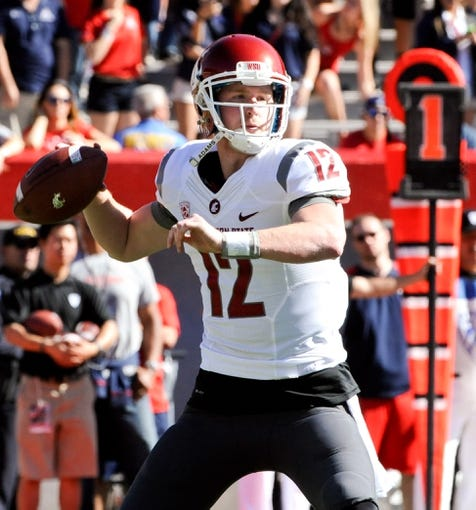 Nov 16, 2013; Tucson, AZ, USA; Washington State Cougars quarterback Connor Halliday (12) throws a pass during the first quarter against the Arizona Wildcats at Arizona Stadium. The Cougars beat the Wildcats 24-17. Mandatory Credit: Casey Sapio-USA TODAY Sports