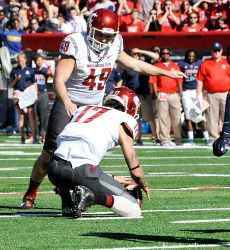 Nov 16, 2013; Tucson, AZ, USA; Washington State Cougars kicker Andrew Furney (49) attempts a field goal during the first quarter against the Arizona Wildcats at Arizona Stadium. The Cougars beat the Wildcats 24-17. Mandatory Credit: Casey Sapio-USA TODAY Sports