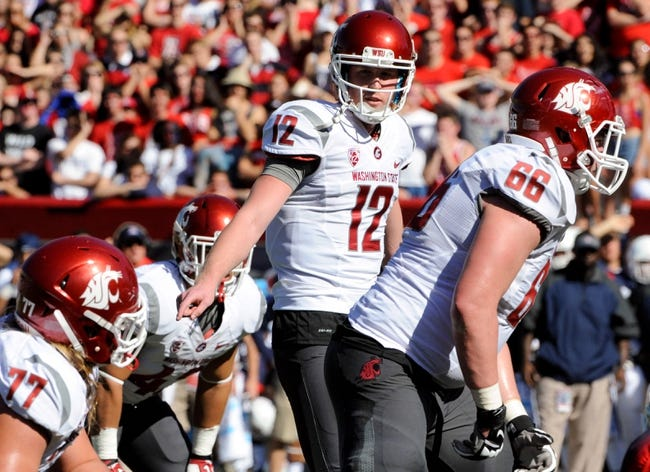 Nov 16, 2013; Tucson, AZ, USA; Washington State Cougars quarterback Connor Halliday (12) signals to his teammates during the first quarter against the Arizona Wildcats at Arizona Stadium. The Cougars beat the Wildcats 24-17. Mandatory Credit: Casey Sapio-USA TODAY Sports