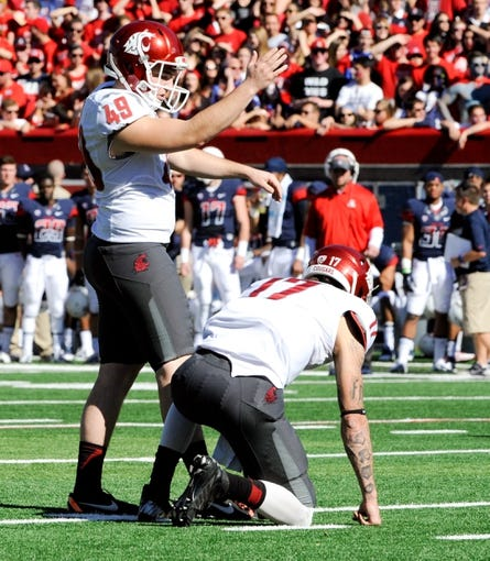 Nov 16, 2013; Tucson, AZ, USA; Washington State Cougars kicker Andrew Furney (49) prepares to attempt a field goal during the first quarter against the Arizona Wildcats at Arizona Stadium. The Cougars beat the Wildcats 24-17. Mandatory Credit: Casey Sapio-USA TODAY Sports
