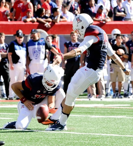 Nov 16, 2013; Tucson, AZ, USA; Arizona Wildcats kicker Jake Smith (86) attempts a field goal during the first quarter against the Washington State Cougars at Arizona Stadium. The Cougars beat the Wildcats 24-17. Mandatory Credit: Casey Sapio-USA TODAY Sports