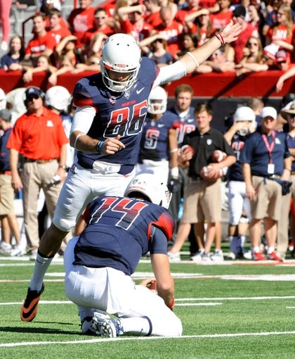 Nov 16, 2013; Tucson, AZ, USA; Arizona Wildcats kicker Jake Smith (86) attempts a field goal against the Washington State Cougars during the second quarter at Arizona Stadium. The Cougars beat the Wildcats 24-17. Mandatory Credit: Casey Sapio-USA TODAY Sports