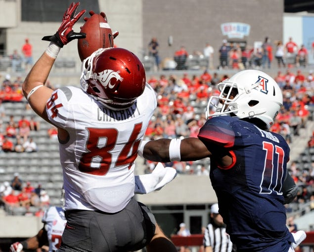 Nov 16, 2013; Tucson, AZ, USA; Washington State Cougars wide receiver River Cracraft (84) tries to catch the ball under pressure from Arizona Wildcats safety William Parks (11) during the first quarter at Arizona Stadium. The Cougars beat the Wildcats 24-17. Mandatory Credit: Casey Sapio-USA TODAY Sports