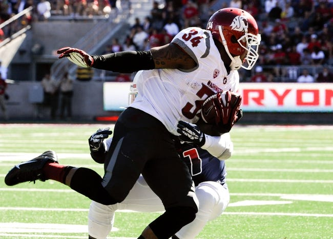 Nov 16, 2013; Tucson, AZ, USA; Washington State Cougars running back Teondray Caldwell (34) runs the ball as he is tackled by Arizona Wildcats safety Tra  Mayne Bondurant (21) during the first quarter at Arizona Stadium. The Cougars beat the Wildcats 24-17. Mandatory Credit: Casey Sapio-USA TODAY Sports