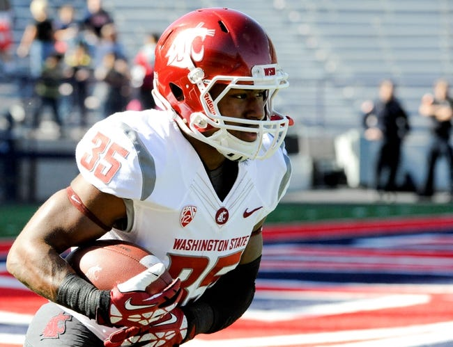 Nov 16, 2013; Tucson, AZ, USA; Washington State Cougars running back Marcus Mason (35) warms up before the first quarter against the Arizona Wildcats at Arizona Stadium. The Cougars beat the Wildcats 24-17. Mandatory Credit: Casey Sapio-USA TODAY Sports