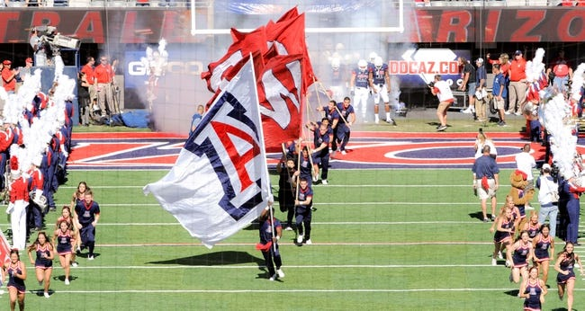 Nov 16, 2013; Tucson, AZ, USA; The Arizona Wildcats cheerleaders run on to the field during the team entry before the first quarter against the Washington State Cougars at Arizona Stadium. The Cougars beat the Wildcats 24-17. Mandatory Credit: Casey Sapio-USA TODAY Sports