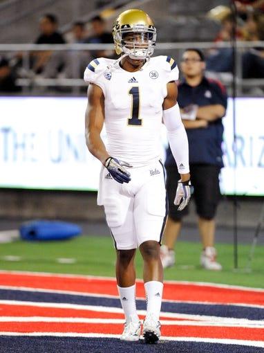 Nov 9, 2013; Tucson, AZ, USA; UCLA Bruins wide receiver Shaquelle Evans (1) warms up before the first quarter against the Arizona Wildcats at Arizona Stadium. Mandatory Credit: Casey Sapio-USA TODAY Sports