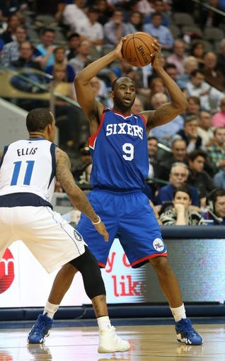 Nov 18, 2013; Dallas, TX, USA; Philadelphia 76ers guard James Anderson (9) looks to pass against the Dallas Mavericks at American Airlines Center. Mandatory Credit: Matthew Emmons-USA TODAY Sports