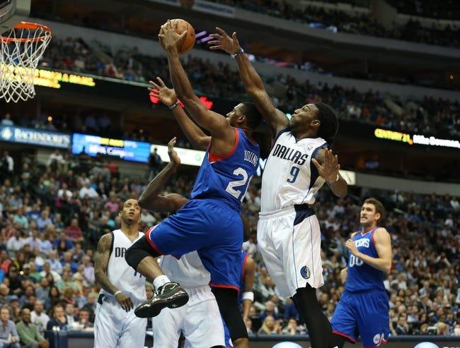 Nov 18, 2013; Dallas, TX, USA; Dallas Mavericks forward Jae Crowder (9) defends against Philadelphia 76ers forward Thaddeus Young (21) at American Airlines Center. Mandatory Credit: Matthew Emmons-USA TODAY Sports