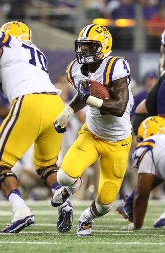 Aug 31, 2013; Arlington, TX, USA; LSU Tigers running back Alfred Blue (4) runs with the ball against the Texas Christian Horned Frogs at AT&T Stadium. Mandatory Credit: Matthew Emmons-USA TODAY Sports