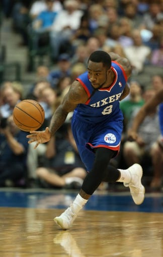 Nov 18, 2013; Dallas, TX, USA; Philadelphia 76ers guard Tony Wroten (8) steals the ball against Dallas Mavericks forward Dirk Nowitzki (not pictured) at American Airlines Center. Mandatory Credit: Matthew Emmons-USA TODAY Sports