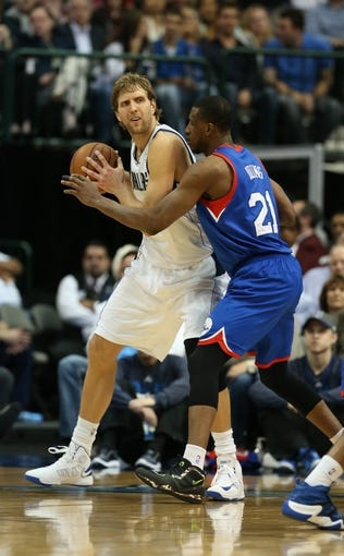 Nov 18, 2013; Dallas, TX, USA; Dallas Mavericks forward Dirk Nowitzki (41) is guarded by Philadelphia 76ers forward Thaddeus Young (21) in the second quarter at American Airlines Center. Mandatory Credit: Matthew Emmons-USA TODAY Sports
