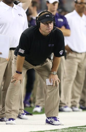Aug 31, 2013; Arlington, TX, USA; Texas Christian Horned Frogs head coach Gary Patterson signals from the sidelines during the game against LSU Tigers at AT&T Stadium. Mandatory Credit: Matthew Emmons-USA TODAY Sports