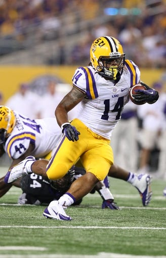 Aug 31, 2013; Arlington, TX, USA; LSU Tigers running back Terrence Magee (14) rushes with the ball against Texas Christian Horned Frogs at AT&T Stadium. Mandatory Credit: Matthew Emmons-USA TODAY Sports
