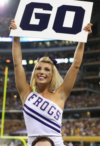 Aug 31, 2013; Arlington, TX, USA; Texas Christian Horned Frogs cheerleader performs on the sidelines during the game against LSU Tigers at AT&T Stadium. Mandatory Credit: Matthew Emmons-USA TODAY Sports