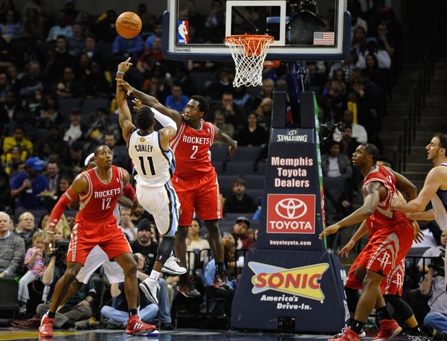 Nov 25, 2013; Memphis, TN, USA; Memphis Grizzlies point guard Mike Conley (11) shoots over Houston Rockets point guard Patrick Beverley (2) during the third quarter at FedExForum. Mandatory Credit: Justin Ford-USA TODAY Sports